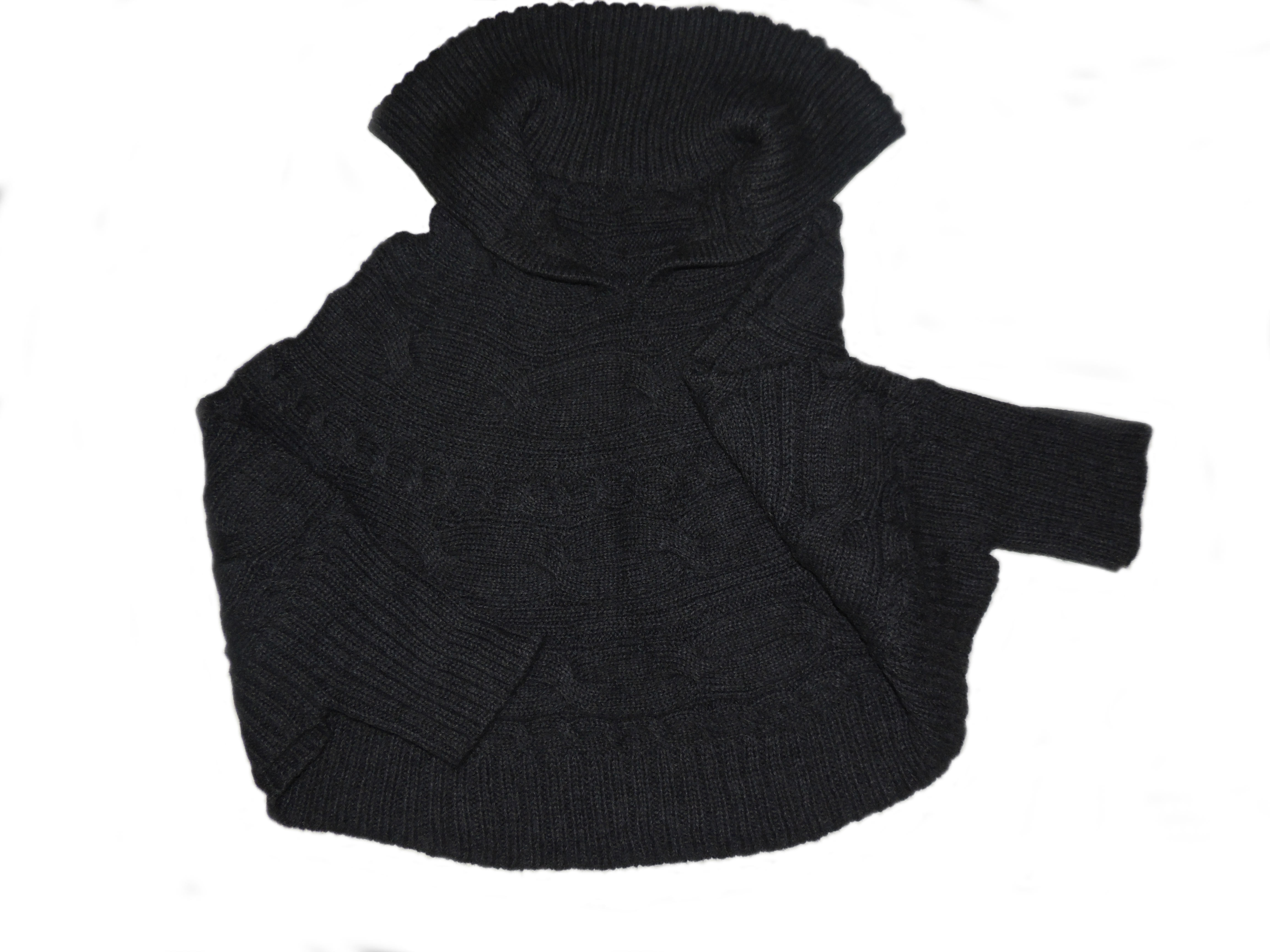 Short hand knitted cape with lapel collar and sleeves.