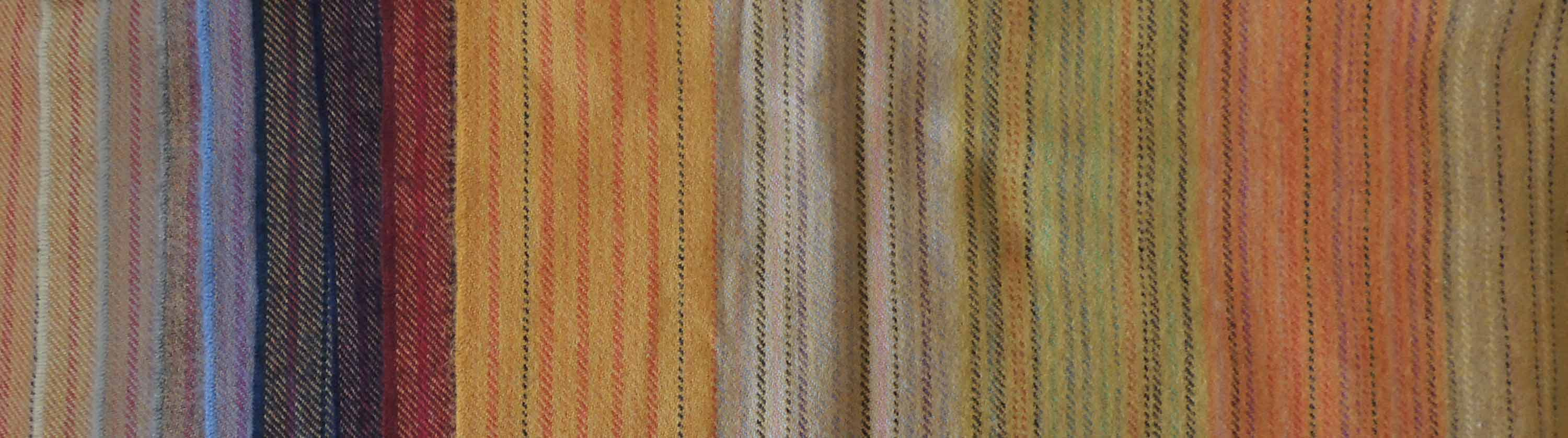 Colored striped throws in alpaca blend.