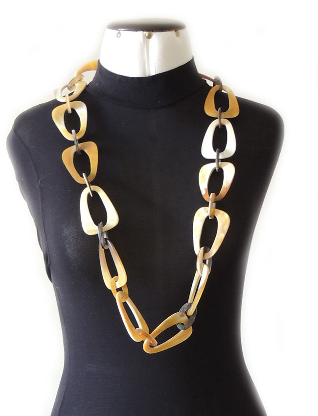 PFL necklace with triangular links with rounded corners and small oval links made from polished buffalo horn.