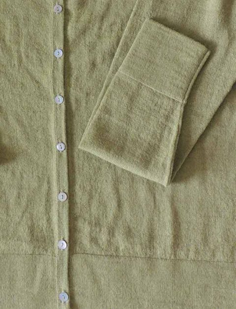 green with  crewneck and mother of pearl button button closure