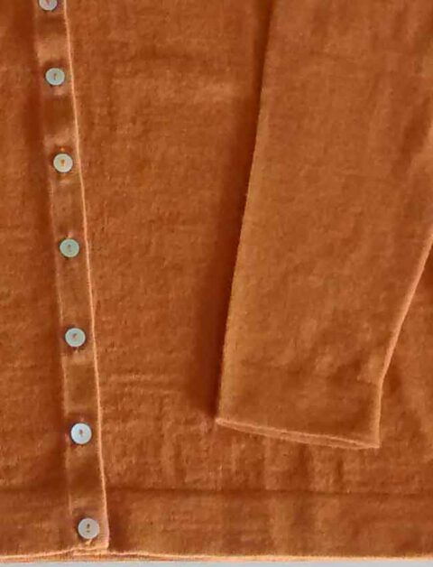 ocher with V-Neck and mother of pearl button button closure in baby alpaca