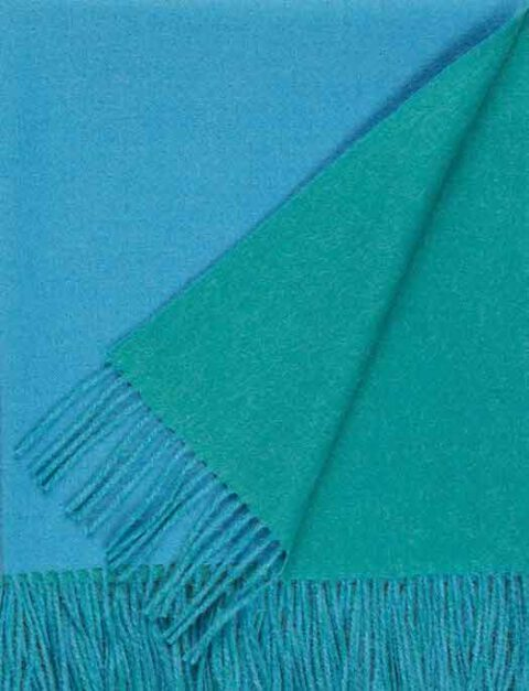 Throw 100% baby alpaca, woven with double face color design and fringes.
