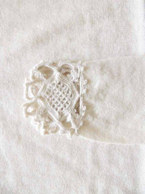 Fine knitted sweater in creme white soft baby alpaca with a round neckline, cuffs and collar