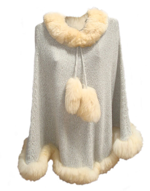 Knitted cape with baby alpaca fur trim.