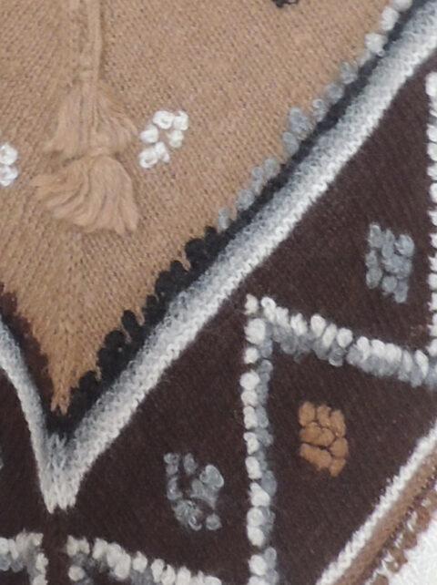 Handknitted cape in rustic alpaca wool