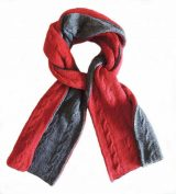 Double knitted, reversible long scarve in Alpaca blend in shades of red and gray.