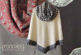 Ponchos with large turtleneck in baby alpaca.