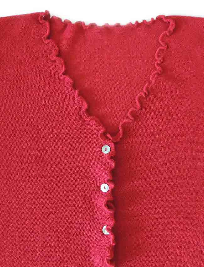 V-Neck and mother of pearl button button closure