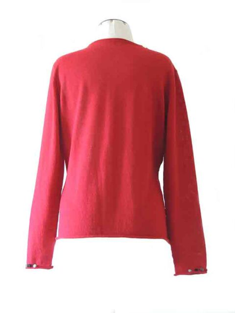 fine knitted red cardigan with embroidered details on the neck and cuffs in baby alpaca