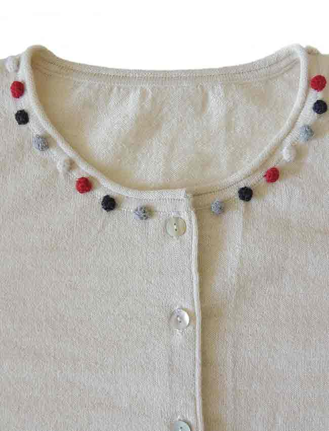 crewneck and mother of pearl button button closure