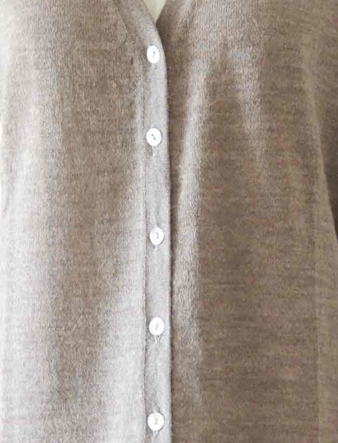 beige with V-Neck and mother of pearl button button closure in baby alpaca
